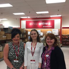 Nicole Moehling, center, a St. Andrew Bay Center client, shown with Tracy and Rhonda, TJ Maxx managers